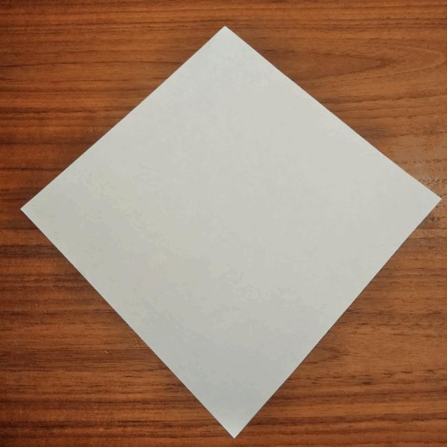 図のように折り紙をおきます。